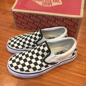 Black and White checkered Vans Slip Ons